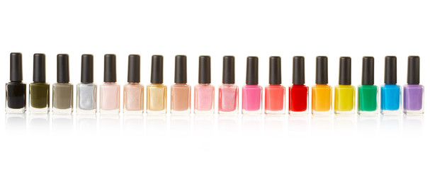 Nail polish bottles colorful group on white, clipping path