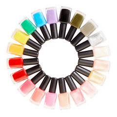 Nail polish colorful bottles circle on white, clipping path