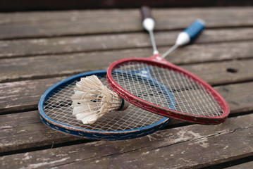 two badminton rackets on the old wooden table