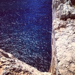 blue water under the cliff