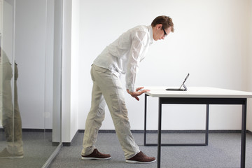 wrists exercise during office work - man with tablet