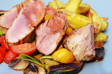 Pork tenderloin - medium, with grilled potatoes and vegetables