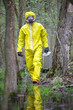 Technician with silver suitcase  in contaminated area