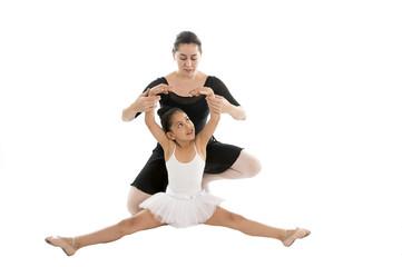 little ballerina dancer learning ballet lesson with teacher