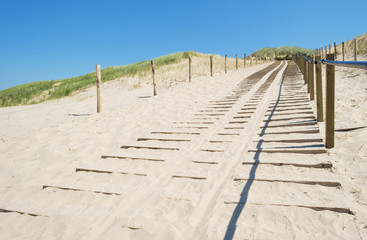 Footpath through a dune of the dutch coast