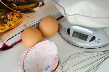 Weighing sugar on scale for baking