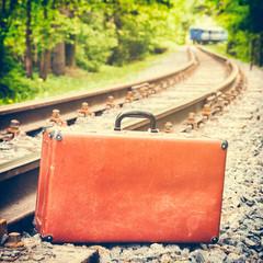 retro suitcase on the railway