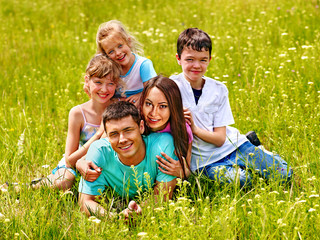 Family on green grass.