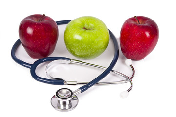 apples with stethoscope concept of healthy diet