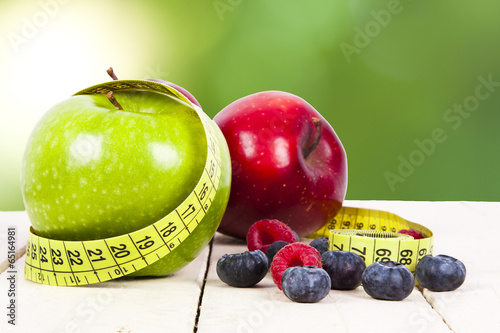 Fototapeta fresh fruit with measuring cintra concept of healthy diet