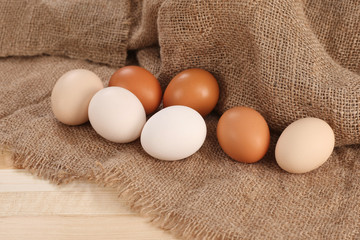 raw eggs  on burlap background