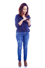 Smiling woman sending a sms with mobile phone, isolated on white