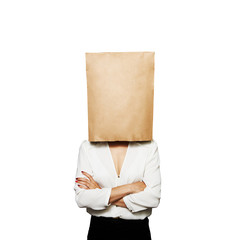 businesswoman hiding under paper bag