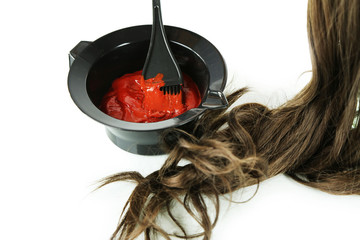 Bowl with hair dye and brush for hair coloring, isolated