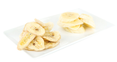 Fresh and dried banana slices, isolated on white