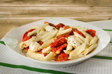 Penne pasta sun dried tomatoes and fresh mozzarella