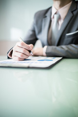 business report and man hand with pen