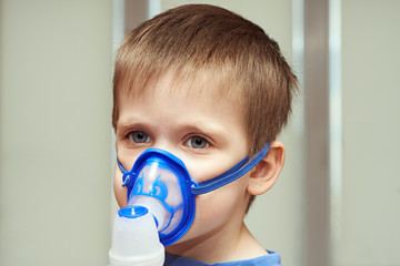 Little boy using an inhaler