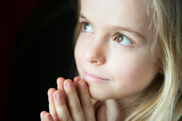 Close Up of Little Girl Praying.