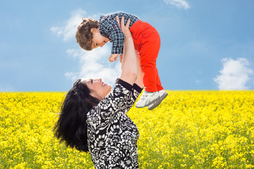 Mom raise uop her son in canola field