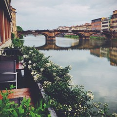 Scrnic view on a Florence bridge across Arno river. Italy.