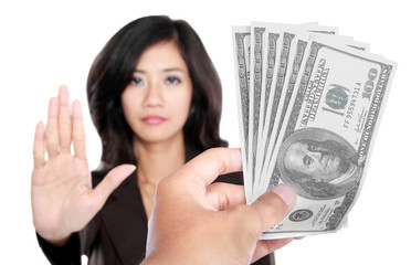 conceptual image of hand give money for corruption
