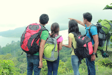Hikers Looking The Map In Countryside