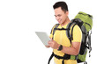 male hiker with backpack using tablet computer