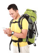portrait of a smiling male hiker with backpack using mobile phon