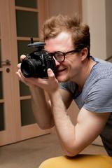 Photographer at work in photographic studio