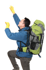 male hiker with backpack climbing