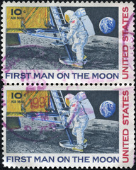 stamp shows Neil Armstrong, first step on the moon