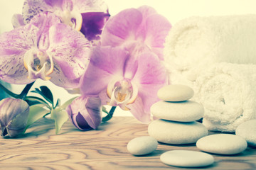 fantastic Spa still life with stone, lilac orchid and towel, vin