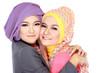 Portrait of two beautiful muslim woman having fun