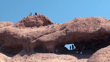 Tourists Inside Hole in the Rock at Papago Park. Arizona, USA.