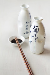 Contemporary Asian food scene of bottles and chopsticks