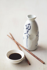 white japanese bottle soy sauce and chopsticks