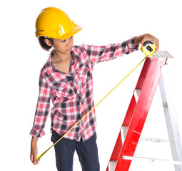 Young Asian Malay girl with a hat and a tape measure on a ladder