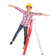 Young Asian Malay girl with hard hat on a ladder