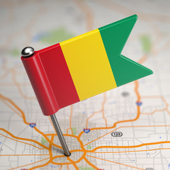 Guinea Small Flag on a Map Background.