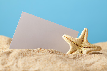 Starfish and blank card on beach