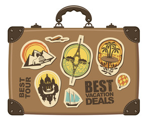 Travel suitcase with stickers of different cities