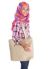 Young Asian Muslim girl with headscarf and handbag