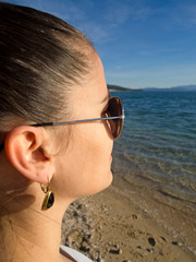 Young woman looking at blue sea