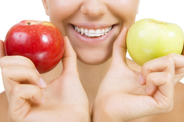 smiling girl with retainer for teeth and apple, Isolated on whit