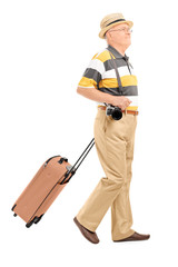 Mature male tourist carrying his baggage