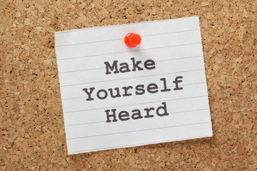 Make Yourself Heard reminder on a cork notice board