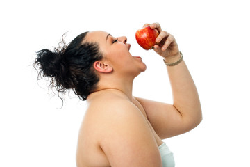 Overweight girl eating red apple.