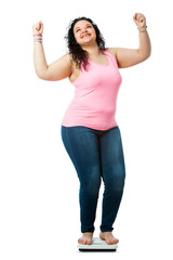Positive overweight girl on diet scale.