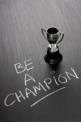Be A Champion with a silver trophy cup for the winner